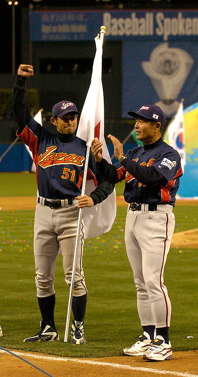 Team Japan's Ichiro Suzuki #51 raises his arms after beatig Team Cuba 10-6 in Final action of the World Baseball Classic at PETCO Park, San Diego, CA.