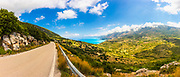 Road leading to the sea arond the sunny valley of Kefalonia