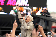 Pink was a surprise guest during the filming of the new T Mobile TV advert at Trafalgar Square, London, no dancing this time - it was a mass karaoke. Members of the public swamped Pink as she sung and led the crowd in song.