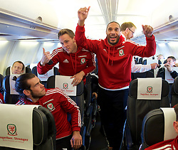 ZENICA, BOSNIA & HERZEGOVINA - Sunday, October 11, 2015: Wales' captain Ashley Williams with Gareth Bale and Chris Gunter on the team's return flight to Cardiff after qualifying for the UEFA Euro 2016 finals despite a 2-0 defeat to Bosnia and Herzegovina during the UEFA Euro 2016 qualifying match. (Pic by David Rawcliffe/Propaganda)