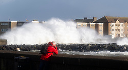 Saltcoats, Scotland, UK. 9 February, 2020.  Storm Ciara at Saltcoats in Ayrshire. With high tide due at midday and winds expected to increase in speed later in the day, the height of the waves are expected to dramatically increase. Pic; Large waves breaking over Saltocats harbour wall . Iain Masterton/Alamy Live News.