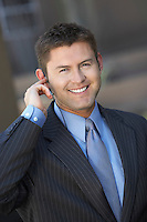 Businessman Using Telephone Headset