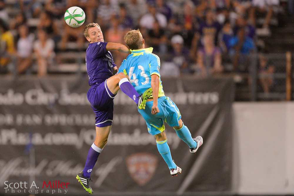 Orlando City Lions midfielder Freddie Braun (16) and Seattle Sounders Henry Wingo (42) go for a ball during a USL Pro soccer game at the Citrus Bowl on Aug. 11, 2013 in Orlando, Florida. <br /> <br /> &copy;2013 Scott A. Miller