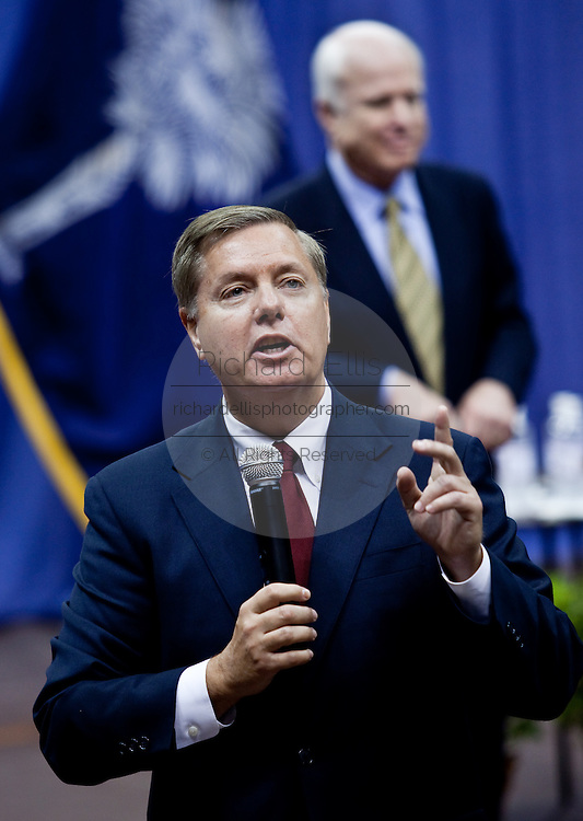 Sen. Lindsay Graham (L) answers a question as Sen. John McCain (R) looks on during a health care town hall meeting September 14, 2009 at the Citadel in Charleston, SC.