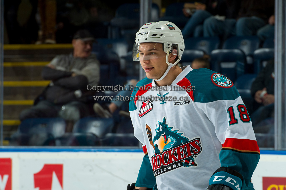 KELOWNA, CANADA - MARCH 3: Carsen Twarynski #18 of the Kelowna Rockets stands on the ice during warm up against the Spokane Chiefs  on March 3, 2018 at Prospera Place in Kelowna, British Columbia, Canada.  (Photo by Marissa Baecker/Shoot the Breeze)  *** Local Caption ***