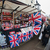 LONDON, ENGLAND - JANUARY 16:  A stall sells British souvenirs at Portobello market on January 16, 2010 in London, England. Portobello traders fear for the Market's future after Lipka's Antiques Arcade, where more than 150 traders had their stalls, was redeveloped to accommodate a large High street chain store.  (Photo by Marco Secchi/Getty Images)