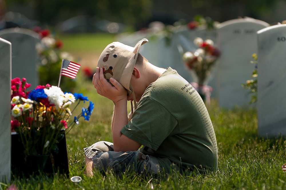 HUNTER YOUNGBLOOD, 10, weeps near the grave of his father, Petty Officer 3rd Class Travis L. Youngblood, 26, of Surrency, Georgia, on Memorial Day in Section 60 of Arlington National Cemetery.