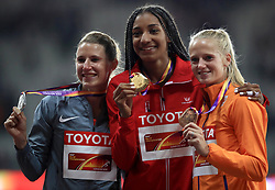 Germany's Carolin Schafer, (silver) Belgium's Nafissatou Thiam (gold) and Netherland's Anouk Vetter (bronze) celebrate with their medals in the Women's Heptathlon during day three of the 2017 IAAF World Championships at the London Stadium.