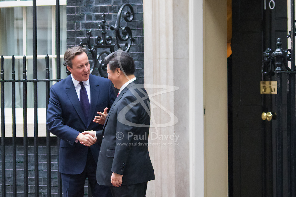 London, October 21st 2015. British Prime Minister David Cameron and his wife Samantha greet Chinese President Xi Jinpeng and his wife Madame Peng as they arrive at 10 Downing Street as part of their four day State Visit to the UK.