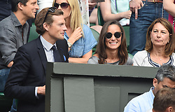 Image licensed to i-Images Picture Agency. 06/07/2014. London, United Kingdom. Nico Jackson with Pippa Middleton her mother Carole Middleton watch the Wimbledon Men's Fina.  Picture by i-Images