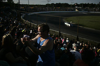 "Spectators and contestants take part in the Fourth of July ""Thrill Show"" at the Seekonk Speedway in Seekonk, Massachusetts on July 5, 2009.  The Thrill Show features 'Hillbilly Racing', demolition derby, stock racing and fireworks among other events.  Photo by Matthew Healey"
