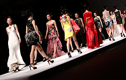 Models present creations from the Minzu University of China Collection during the Mercedes-Benz China Fashion Week in Beijing, China, 27 March 2013. The Mercedes-Benz China Fashion Week will run from 25 to 30 March.