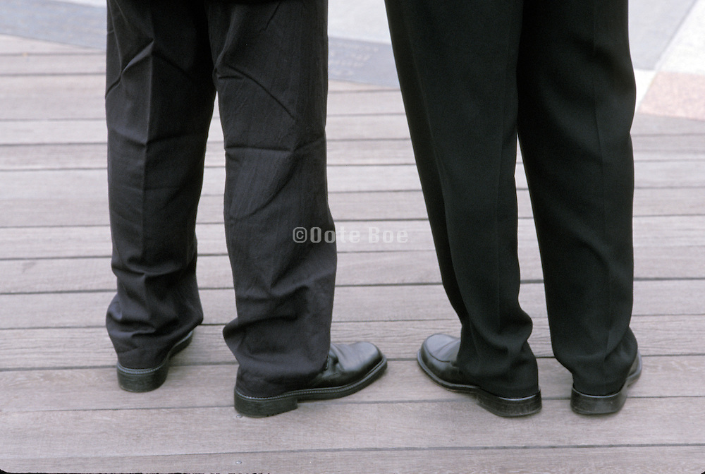 two pair of business legs