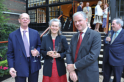 Left to right, The EARL OF CAITHNESS, PENNY WILSON and DAVID HOWARD at a reception hosted by the Friends of the Castle of Mey held at the Goring Hotel, Beeston Place, London on 22nd May 2012.
