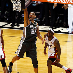 Jun 6, 2013; Miami, FL, USA; San Antonio Spurs power forward Tim Duncan (21) lays the ball up past Miami Heat small forward LeBron James (6) in the second quarter during game one of the 2013 NBA Finals at the American Airlines Arena. Mandatory Credit: Derick E. Hingle-USA TODAY Sports