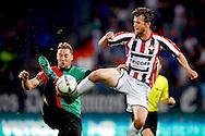 28-08-2015 VOETBAL:WILLEM II- NEC NIJMEGEN:TILBURG<br /> Rens van Eijden van NEC Nijmegen  in duel met Erik Falkenburg van Willem II <br /> <br /> Foto: Geert van Erven