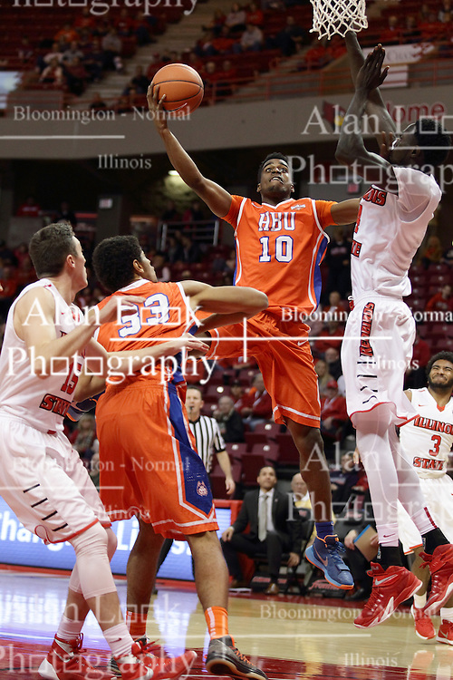"""21 November 2015: Trey Patterson(10) puts a hand to the face of Daouda """"David"""" Ndiaye (4) to get enough room for a hook shot. Illinois State Redbirds host the Houston Baptist Huskies at Redbird Arena in Normal Illinois (Photo by Alan Look)"""