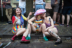 © Licensed to London News Pictures . 25/08/2019. Manchester, UK. Two women share a kiss . Revellers in Manchester's Gay Village during the city's annual Gay Pride festival , which celebrates LGBTQ+ life and is the largest of its type in Europe . Photo credit: Joel Goodman/LNP