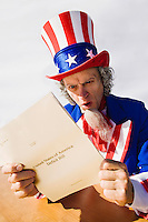 Uncle Sam sitting at a table looking surprised and astounded as he reads the United States deficit bill.