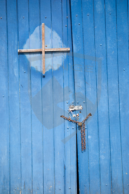 blue doors at a marina in buzios, rio de janeiro, brazil