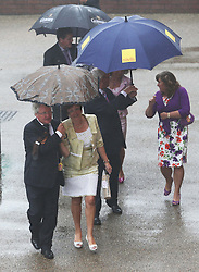 Not so Glorious Goodwood… Racegoers get caught up in torrential rainfall as they arrive for  the opening day of Glorious Goodwood in the UK, Tuesday, 30th July 2013 <br /> Picture by Stephen Lock / i-Images