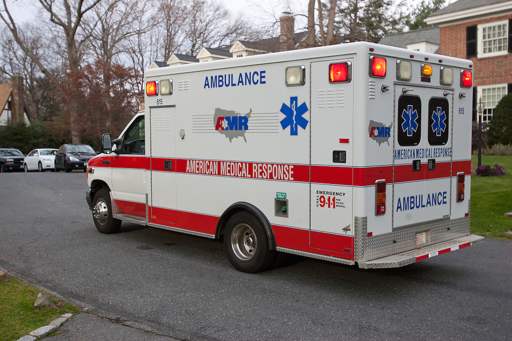Wellesley, MA 11/28/2011.An ambulance departs the scene of an alleged sexual assault and home invasion on Edmunds Rd. in Wellesley on Monday afternoon..Alex Jones / www.alexjonesphoto.com