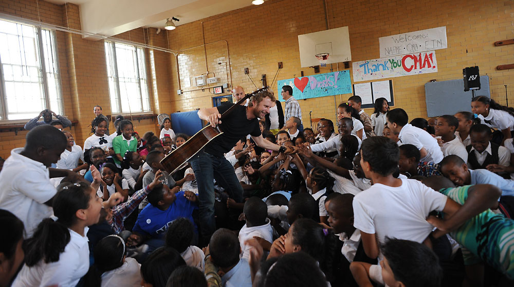 Dierks Bentley is greeted by an enthusiastic crowd at a Bronx High School