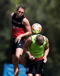 Luke Ayling of Bristol City battles for the high ball with Aaron Wilbraham of Bristol City  - Photo mandatory by-line: Joe Meredith/JMP - Mobile: 07966 386802 - 16/07/2015 - SPORT - Football - Albufeira -  - Pre-Season Training