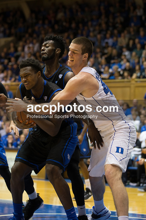 DURHAM, NC - DECEMBER 05: Marshall Plumlee #40 of the Duke Blue Devils defends Nick Perkins #33 of the Buffalo Bulls during a 59-82 Duke Blue Devils win on December 05, 2015 at Cameron Indoor Stadium in Durham, North Carolina. (Photo by Peyton Williams/Getty Images) *** Local Caption *** Marshall Plumlee;Nick Perkins