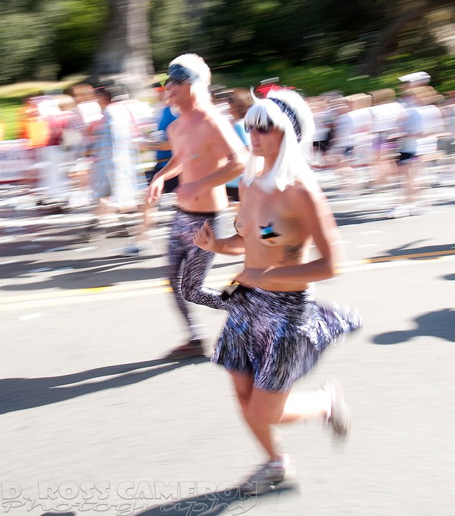 An unidentified couple run shirtless through Golden Gate Park at the 98th annual Bay to Breakers 12K footrace in San Francisco, Sunday, May 17, 2009. The 7.46-mile race, which attracts upwards of 60,000 participants, is well known for its wacky costumes -- and those who wear nothing at all. (Photo by D. Ross Cameron)