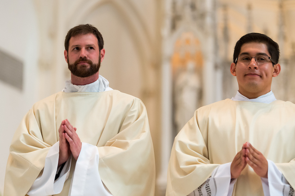 DENVER, CO - MAY 16: The Rev. Joseph Marc McLagan (L) and the Rev. Erik Vigil Reyes stand before the congregation during their ordination as priests in the Archdiocese of Denver at the Cathedral Basilica of the Immaculate Conception on May 16, 2015, in Denver, Colorado. (Photo by Daniel Petty/Denver Catholic Register)