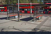 At the beginning of the fourth week of the UK government's lockdown during the Coronavirus pandemic, and with 120,067 UK reported cases with 16,060 deaths, buses remain stationary in front of deserted bus shelters at Waterloo bus station in South London, on 20th April 2020, in London, England.