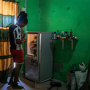 Daboya / Elizabeth Mohammed (23), Single:<br /> <br /> You can still see where the flood waters reached on the walls of our home. I sell soft drinks. The water damaged my fridge so it doesn't cool anymore. I used to make about 60 cedis every month but since my drinks don't cool, business is bad and I have started living on my capital.