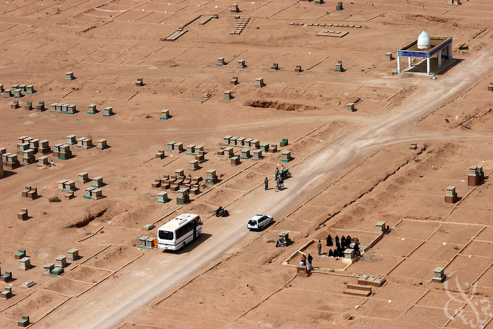 Iraqi Shiites hold a funeral in the giant Najaf cemetary  May 12, 2006.