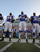 Buffalo Bills wide receiver Marcus Easley (81) stands at attention during the playing of the National Anthem before the 2014 NFL Pro Football Hall of Fame preseason football game against the New York Giants on Sunday, Aug. 3, 2014 in Canton, Ohio. The Giants won the game 17-13. ©Paul Anthony Spinelli