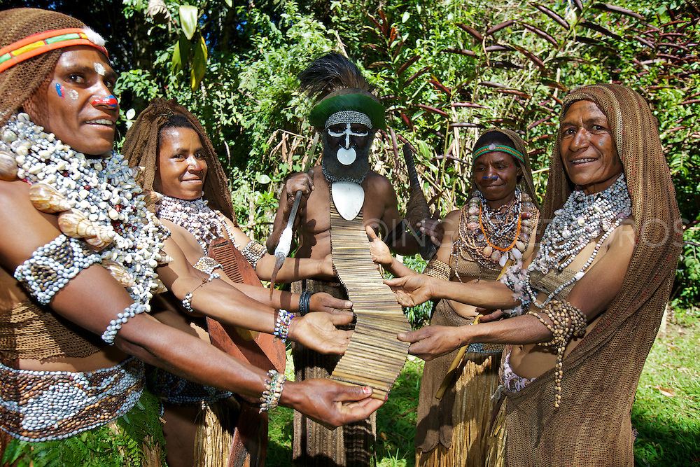 Chief and his four wife's holding a necklace showing how many pigs he has killed.<br /> Exclusive at Getty Images<br /> http://www.gettyimages.com.au/Search/Search.aspx?contractUrl=2&amp;language=en-US&amp;assetType=image&amp;p=ingetje+tadros#2