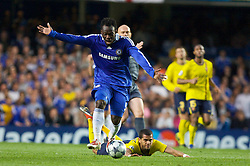 LONDON, ENGLAND - Wednesday, May 6, 2009: Chelsea's Michael Essien and Barcelona's Daniel Alves during the UEFA Champions League Semi-Final 2nd Leg match at Stamford Bridge. (Photo by Carlo Baroncini/Propaganda)