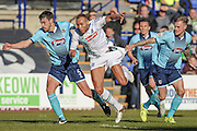 Richard Tait (Grimsby Town) pulls Lois Maynard (Tranmere Rovers) back by the shorts during the Vanarama National League match between Tranmere Rovers and Grimsby Town FC at Prenton Park, Birkenhead, England on 30 April 2016. Photo by Mark P Doherty.