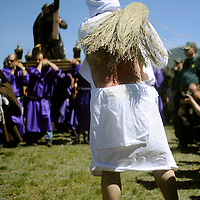 """Picaos penitents whip themselves during the """"Santa Vera Cruz"""" brotherhood procession of the Holy Week in San Vicente de la Sonsierra, 330km north of Madrid, on April 18, 2014. PHOTO/ RAFA RIVAS"""