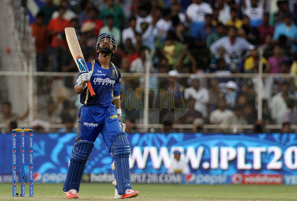 Rajasthan Royals player Ajinkya Rahane raises his bat after scoring a fifty during match 15 of the Pepsi IPL 2015 (Indian Premier League) between The Rajasthan Royals and The Chennai Super Kings held at the Sardar Patel Stadium in Ahmedabad , India on the 19th April 2015.<br /> <br /> Photo by:  Vipin Pawar / SPORTZPICS / IPL