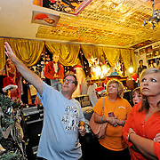 Mike Butcher, from Columbus, Ohio, leads a tour at Graceland Too in Holly Springs, Miss., Tuesday, Aug. 12, 2014. (Photo/Thomas Graning)