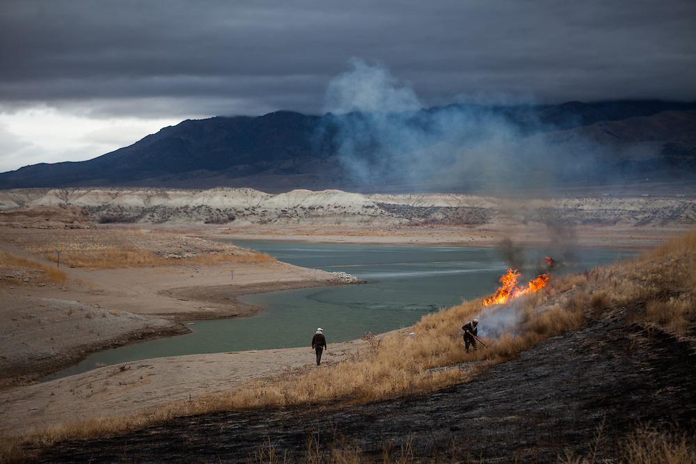 LOVELOCK, NV - JANUARY 29, 2014: State Park rangers burn weeds on the exposed lakebed of the Rye Patch reservoir which sits at 3.5% capacity as a drought emergency is declared in Nevada. CREDIT: Max Whittaker for The New York Times