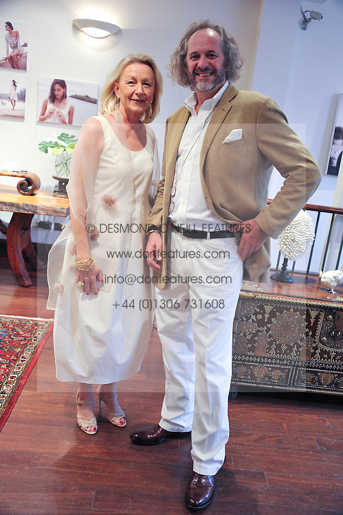 PATRICK MAVROS and his wife CATJA at a party to celebrate the launch of the new Mauritius Collection of jewellery by Forbes Mavros held at Patrick Mavros, 104-106 Fulham Road, London SW3 on 5th July 2011.