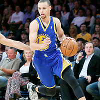 11 April 2014: Golden State Warriors guard Stephen Curry (30) drives past Los Angeles Lakers guard Kendall Marshall (12) during the Golden State Warriors 112-95 victory over the Los Angeles Lakers at the Staples Center, Los Angeles, California, USA.
