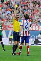 Referee Jaime Latre shows a yellow card to Atletico de Madrid´s Diego Godin during 2014-15 La Liga match between Atletico de Madrid and Athletic Club at Vicente Calderon stadium in Madrid, Spain. May 02, 2015. (ALTERPHOTOS/Luis Fernandez)