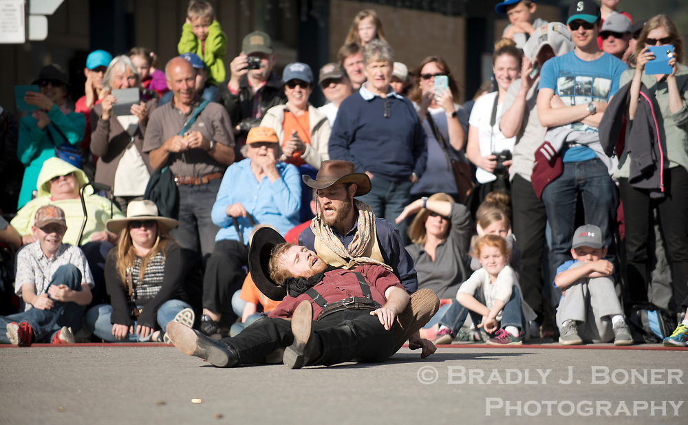 Tourists watch the first Town Square Shootout of the season play out Saturday on the northeast corner of the Jackson Town Square on Saturday during Old West Days. The longest-running shootout in the country is entering its 60th year this summer.