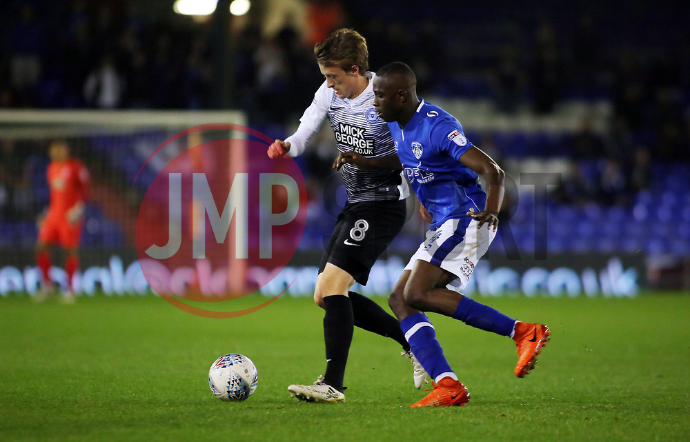 Chris Forrester of Peterborough United is put under pressure by Ousmane Fane of Oldham Athletic - Mandatory by-line: Joe Dent/JMP - 26/09/2017 - FOOTBALL - Sportsdirect.com Park - Oldham, England - Oldham Athletic v Peterborough United - Sky Bet League One