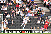 Milton Keynes Dons midfielder Ryan Watson (7) heads the ball during the EFL Sky Bet League 2 match between Milton Keynes Dons and Grimsby Town FC at stadium:mk, Milton Keynes, England on 21 August 2018.