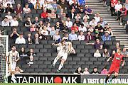 Milton Keynes Dons midfielder Ryan Watson (7) heads the ball during the EFL Sky Bet League 2 match between Milton Keynes Dons and Grimsby Town FC at stadium:mk, Milton Keynes, England on 21 August 2018.