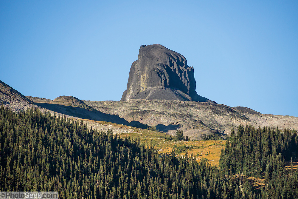 See the volcanic pinnacle of Black Tusk (2319 m or 7608 ft) rising above Taylor Meadows. The Black Tusk is a remnant of an extinct andesitic stratovolcano which formed 1.3-1.1 million years ago: after long glacial erosion, renewed volcanism 170,000 years ago made the lava flow and dome forming the tooth-shaped summit.  Garibaldi Provincial Park, in the Coast Range, British Columbia, Canada. Garibaldi Park is east of the Sea to Sky Highway (Route 99) between Squamish and Whistler.